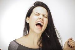 Mädchen, das Gefühl mit Gesichtsfunktionen zeigt Stockbilder