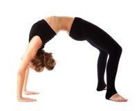 Mädchen, das Gymnastik auf weißem Hintergrund tut lizenzfreies stockfoto