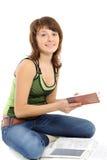 Mädchen, das Heimarbeit tut Stockfoto