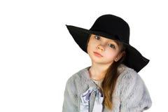 Mädchen, das Hut und große Augen hält lizenzfreie stockfotos