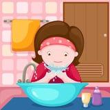 Mädchen, das ihr Gesicht im Badezimmer wäscht stock abbildung