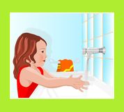 Mädchen, das ihre Hände wäscht Lizenzfreies Stockfoto