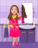 Mädchen, das ihre Zähne putzt Stockbild