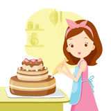 Mädchen, das Kuchen macht Lizenzfreie Stockfotos