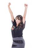 Mädchen, das mit den Armen oben zujubelt Lizenzfreies Stockfoto