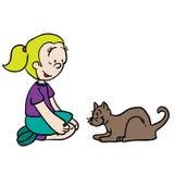 Mädchen, das mit Katze spielt Lizenzfreie Stockfotos