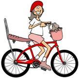 Mädchen, das rotes Fahrrad fährt lizenzfreie abbildung