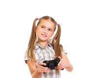 Mädchen, das Spiel spielt. Stockfoto