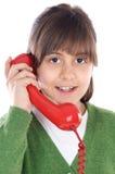 Mädchen, das am Telefon spricht stockfotografie