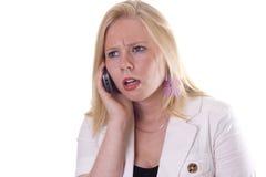 Mädchen, das am Telefon wütend wird Lizenzfreie Stockfotografie