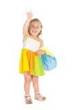 Mädchen, das von der Hand wellenartig bewegt Stockbilder