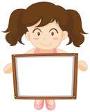 Mädchen, das whiteboard in den Händen hält Stockbild