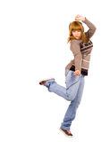 Mädchen, das zum Rhythmus von Musik in den Kopfhörern tanzt Lizenzfreie Stockfotos