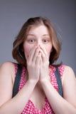 Mädchen deckte ihren Mund ab Stockfotografie