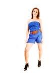 Mädchen in den blauen kurzen Hosen. Lizenzfreie Stockfotos