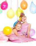 Mädchen in den Partyhüten Stockbilder