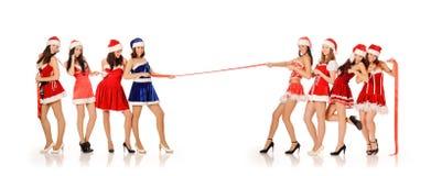 Mädchen in den Weihnachtsmann-Kostümen Lizenzfreies Stockbild