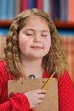 Mädchen-Denken Lizenzfreie Stockbilder