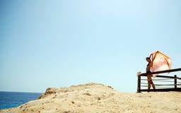 Mädchen an der Küste Stockfoto