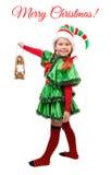 Mädchen in der Klage der Weihnachtselfe mit Lampe auf Weiß Stockfotografie