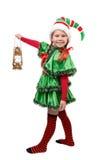 Mädchen in der Klage des Weihnachtselfs mit Schmieröllampe Lizenzfreie Stockfotografie