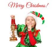 Mädchen in der Klage des Weihnachtselfs mit Schmieröllampe Stockbild