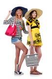 Mädchen in der Sommerkleidung mit den Taschen an lokalisiert Stockbild
