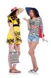 Mädchen in der Sommerkleidung mit den Taschen lokalisiert auf Stockbild