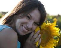 Mädchen in der Sonnenblume Stockbild