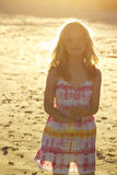 Mädchen in der Sonnenuntergangbeleuchtung Lizenzfreies Stockbild