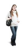 Mädchen in der Strickjacke mit Handtasche Stockbild