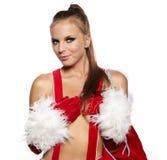 Mädchen in der Weihnachtsmann-Klage mit Geschenkbeutel über Weiß Stockbilder
