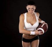 Mädchen des amerikanischen Fußballs Stockfotos