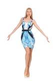 Mädchen des blonden Haares im mini blauen Kleid an lokalisiert Lizenzfreies Stockfoto