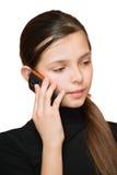Mädchen des jungen jugendlich, das durch Telefon benennt Lizenzfreie Stockfotografie