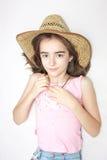 Mädchen des jungen jugendlich mit Cowboyhut Stockfoto