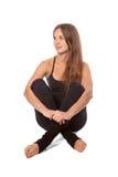 Mädchen, die in einem Yoga sich entspannen Lizenzfreie Stockfotos