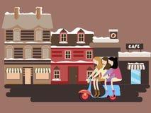Mädchen, die Roller vor Straßenaltbaueuropa-vintge Artfassaden reiten Stockfoto