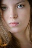 Mädchen-drastische Gesichts-Nahaufnahme Stockfoto