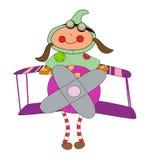 Mädchen in einem Pappschachtelflugzeug Lizenzfreies Stockbild