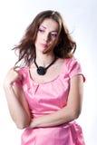 Mädchen in einem rosafarbenen Kleid Lizenzfreie Stockfotografie