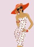 Mädchen in einem roten Hut Stockbilder
