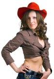 Mädchen in einem roten Hut und in den Jeans Stockfotos