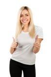 Mädchen in einem weißen T-Shirt zeigt Daumen Stockbilder