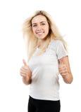 Mädchen in einem weißen T-Shirt zeigt zwei Daumen Stockfotografie