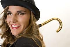 Mädchen in einem Werfer-Hut Stockbild