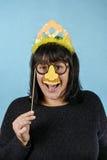 Mädchen in einer festlichen Maske Stockbilder