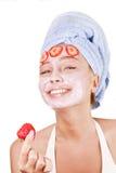 Mädchen in einer Gesichtsmaske Stockbild