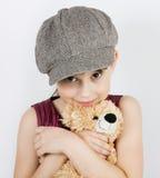 Mädchen in einer grauen Schutzkappe lizenzfreies stockfoto