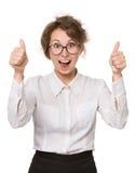 Mädchen in einer weißen Bluse steht auf einem weißen Hintergrund, Gesten, Gefühle auf ihrem Gesicht Lizenzfreie Stockfotos